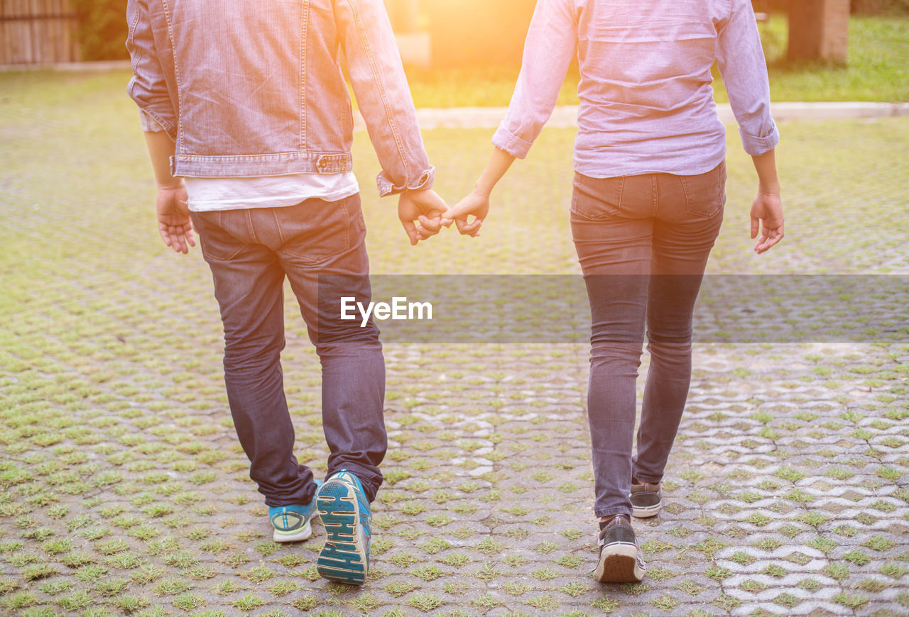 love, two people, togetherness, positive emotion, bonding, holding hands, emotion, casual clothing, couple - relationship, heterosexual couple, women, men, walking, adult, romance, leisure activity, friendship, young adult, people, day, outdoors