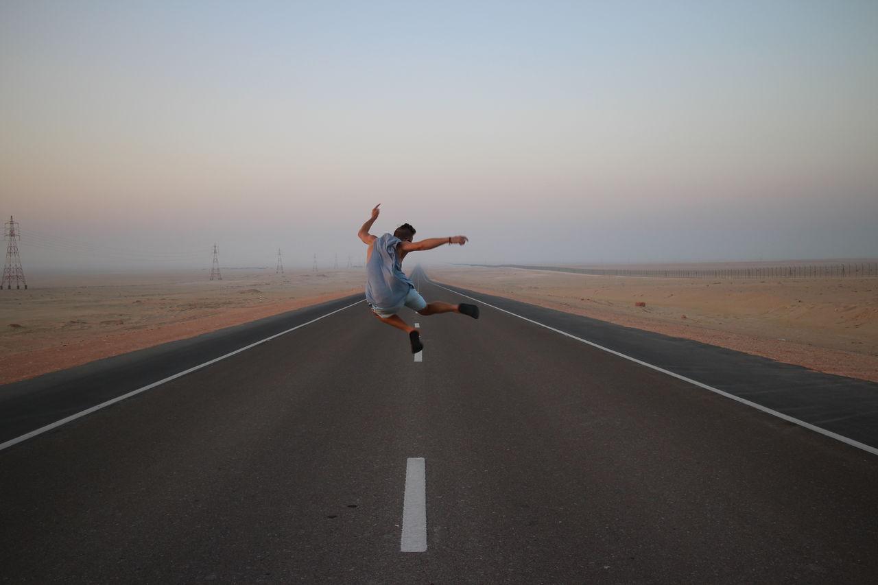 Full Length Of Man Jumping
