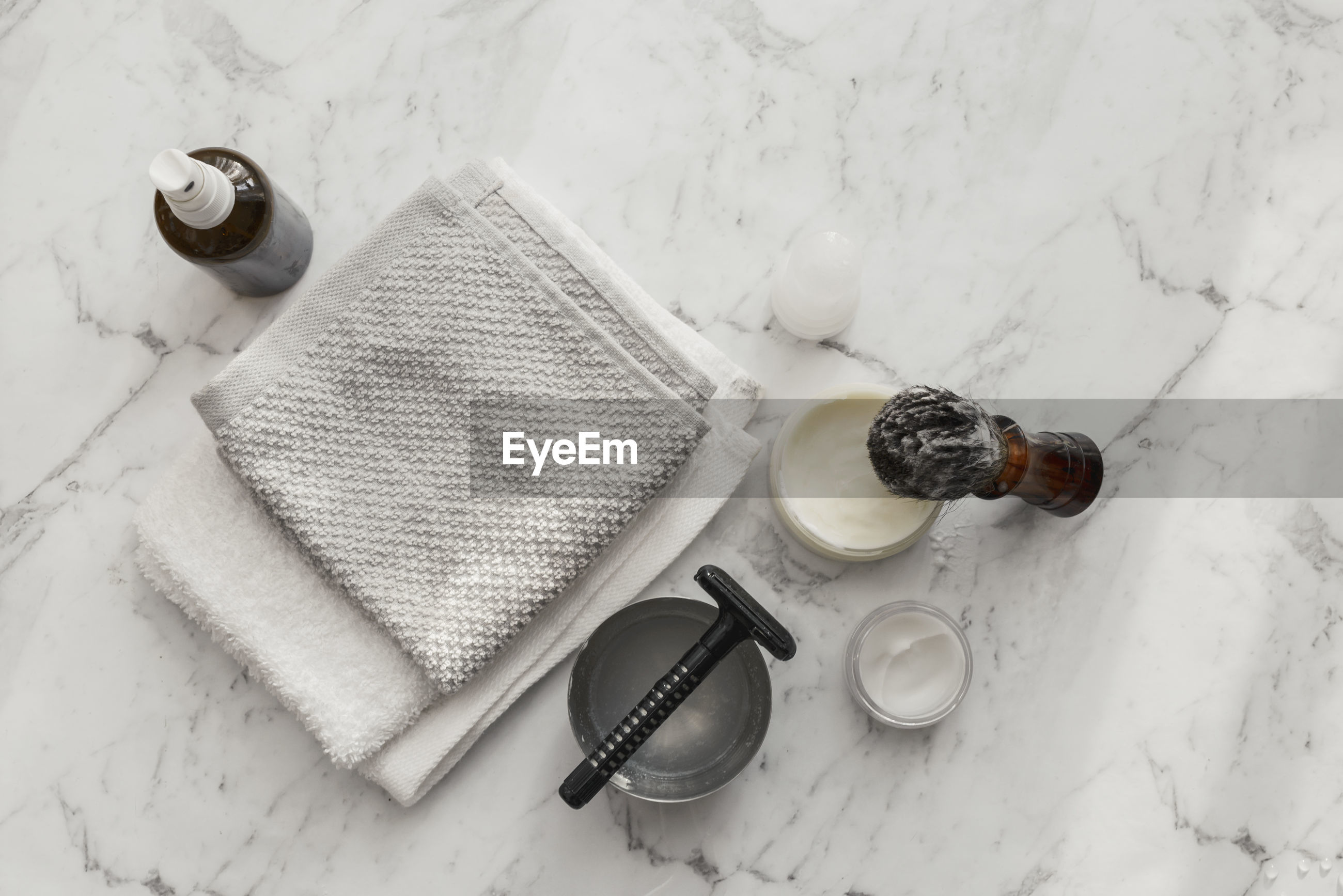 High angle view of shaving equipment on marble table