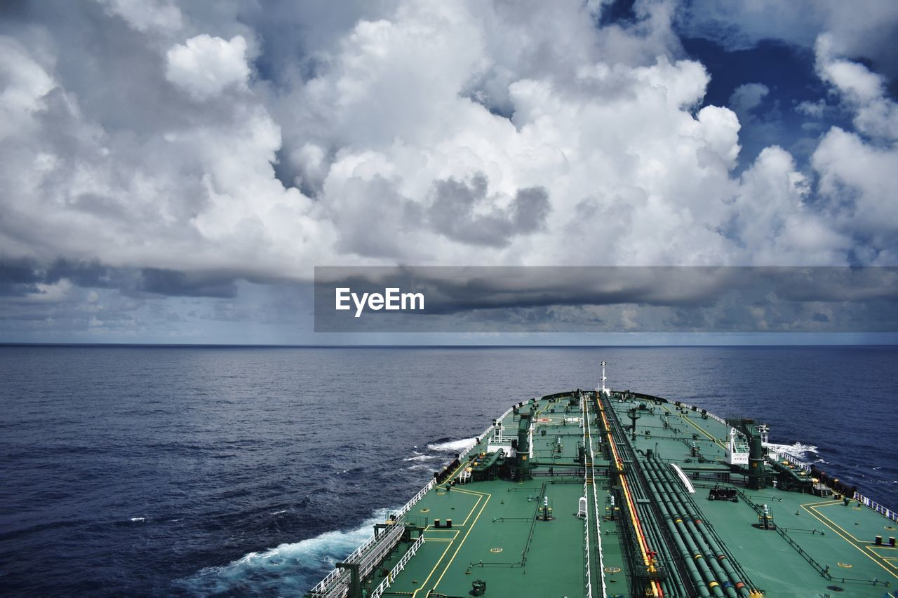 Ship At Sea Against Cloudy Sky