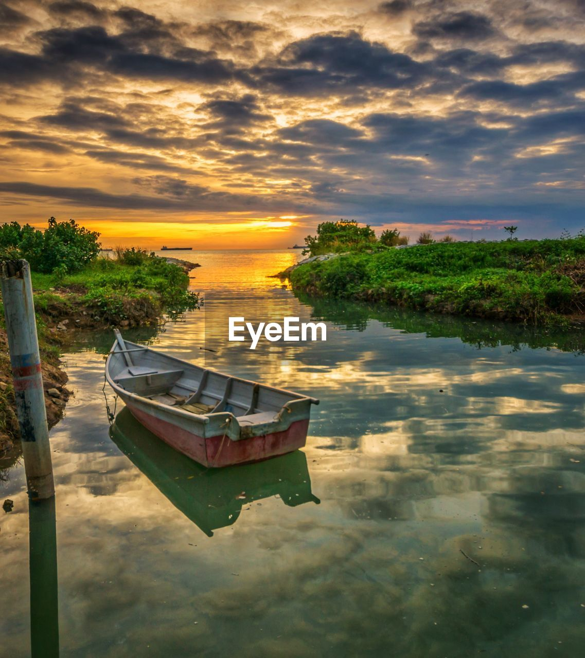 nautical vessel, water, reflection, sky, moored, nature, transportation, tranquility, sunset, cloud - sky, mode of transport, beauty in nature, tranquil scene, boat, no people, scenics, outdoors, waterfront, tree, sea, day