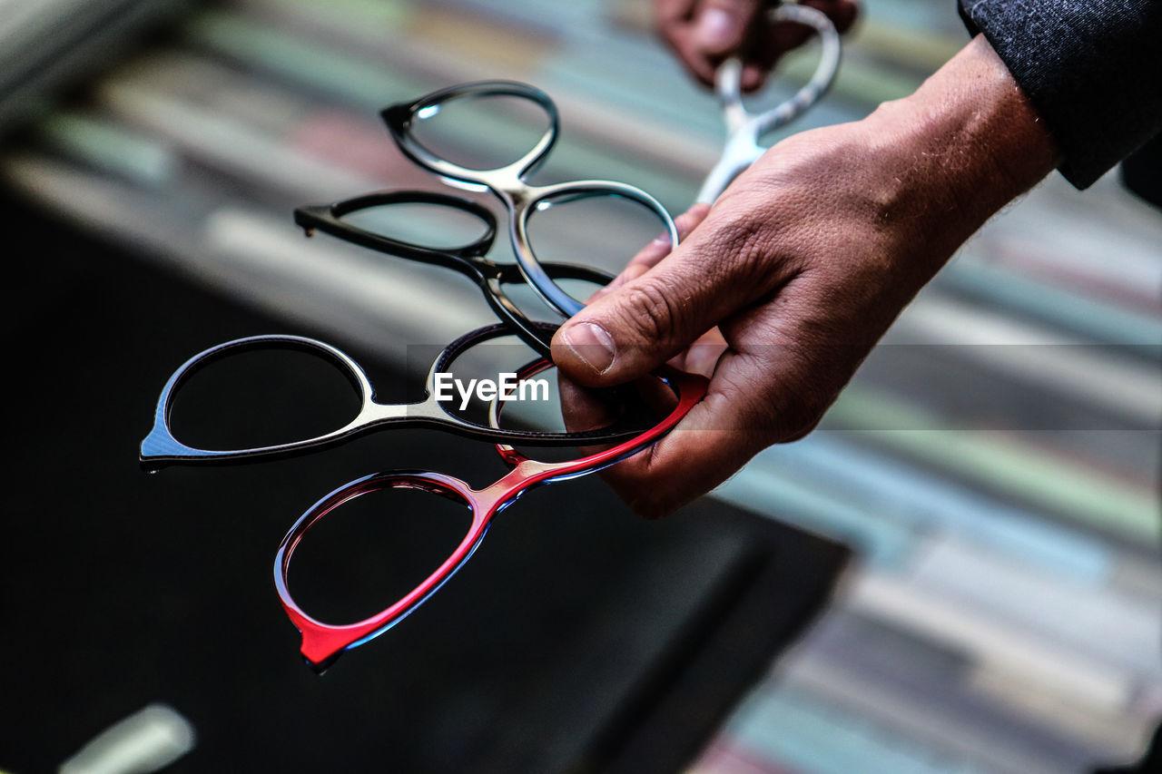 Close-Up Of Man Holding Eyeglasses