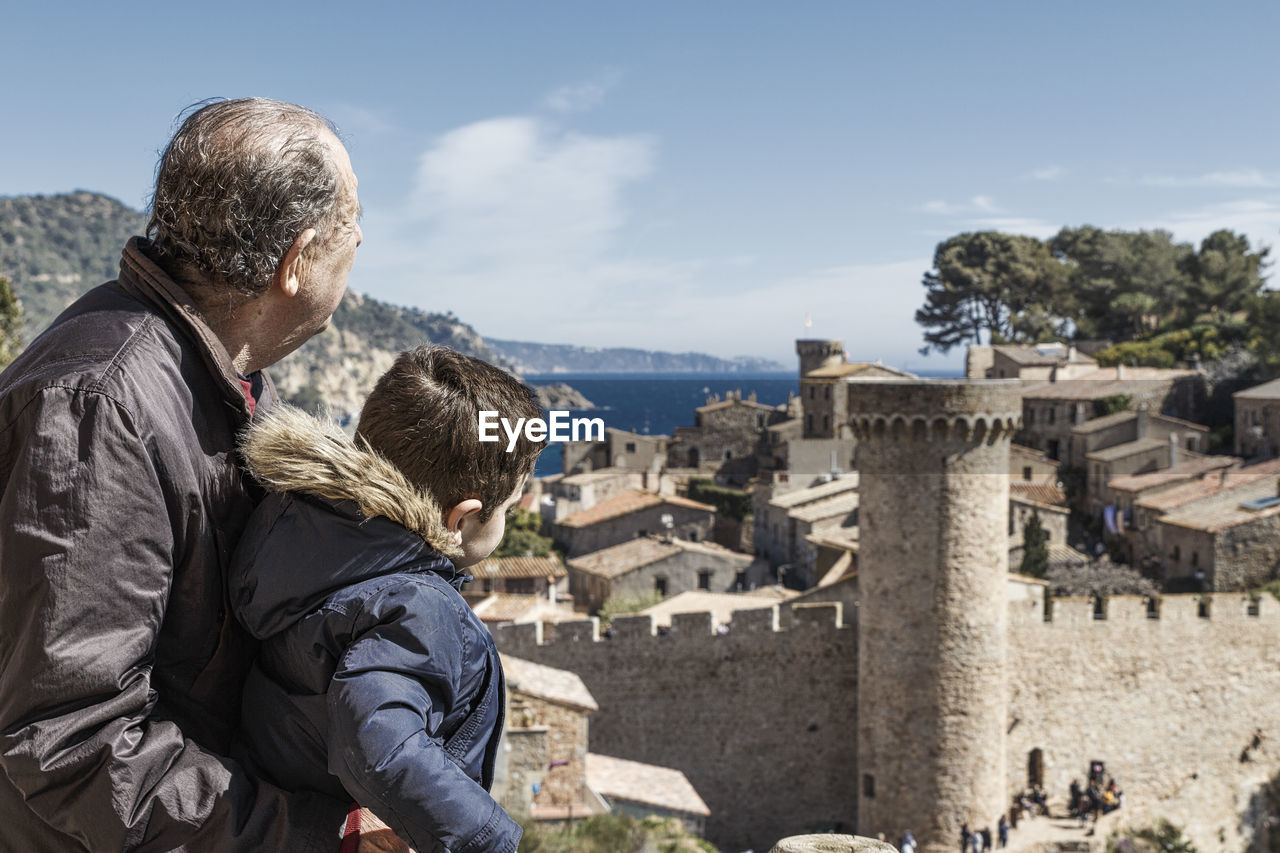 Grandson And Grandfather Looking At View Of Tossa De Mar