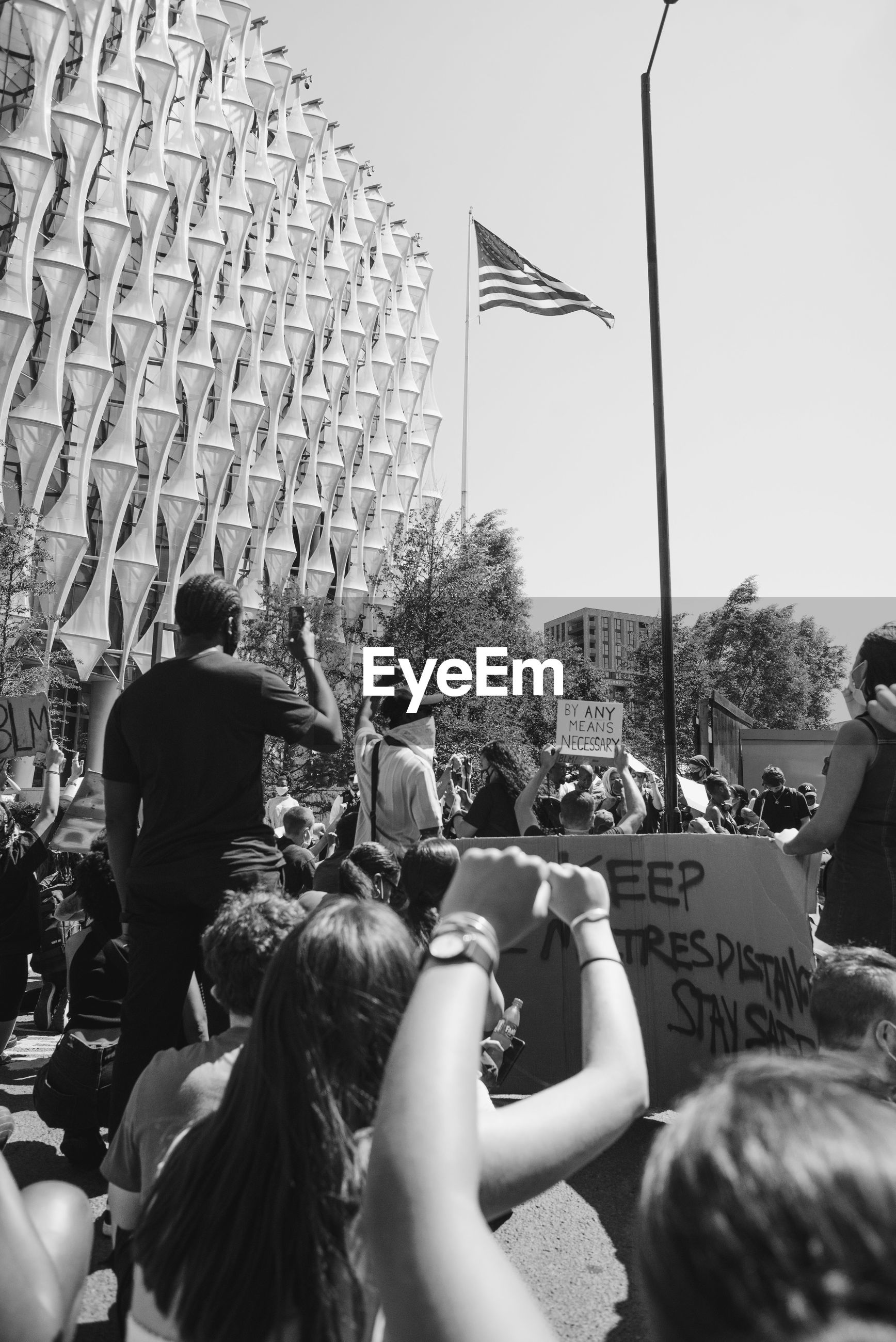 crowd, group of people, flag, large group of people, event, black and white, black, monochrome, monochrome photography, adult, women, architecture, men, day, arts culture and entertainment, sky, celebration, patriotism, togetherness, outdoors, nature, rear view, person, audience, city, lifestyles, leisure activity