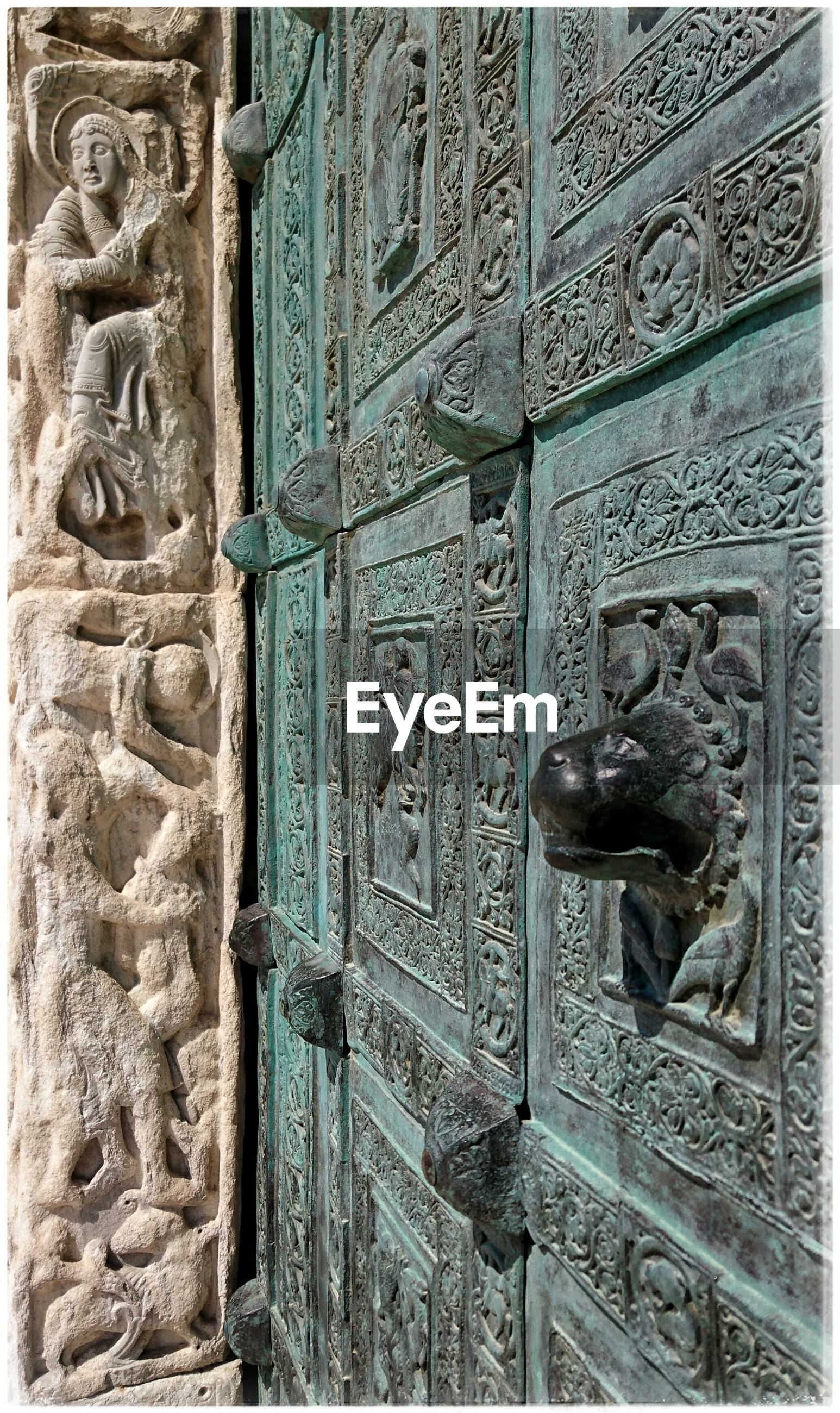 architecture, built structure, art and craft, art, building exterior, door, ornate, old, carving - craft product, creativity, history, wall - building feature, design, closed, window, human representation, pattern, close-up, wall, day