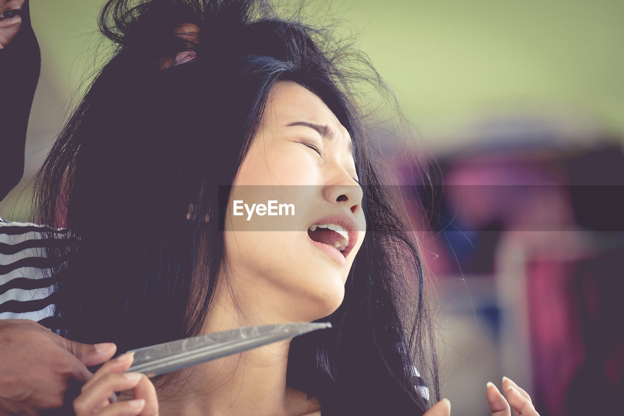 Cropped Image Of Criminal Holding Knife By Frightened Woman
