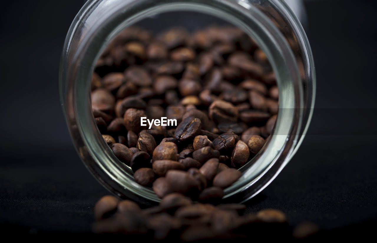 CLOSE-UP OF COFFEE BEANS IN GLASS
