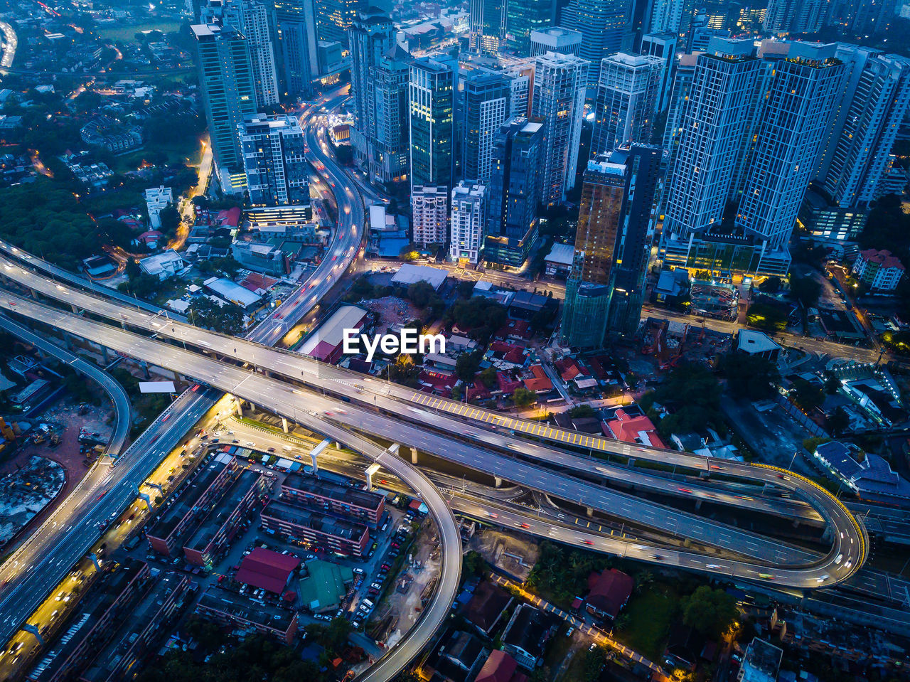 Aerial View Of Illuminated Highway Amidst Buildings At Night