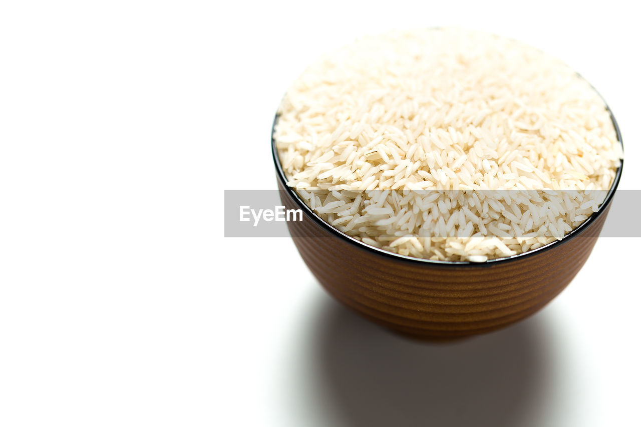 Close-Up Of Rice In Bowl Over White Background