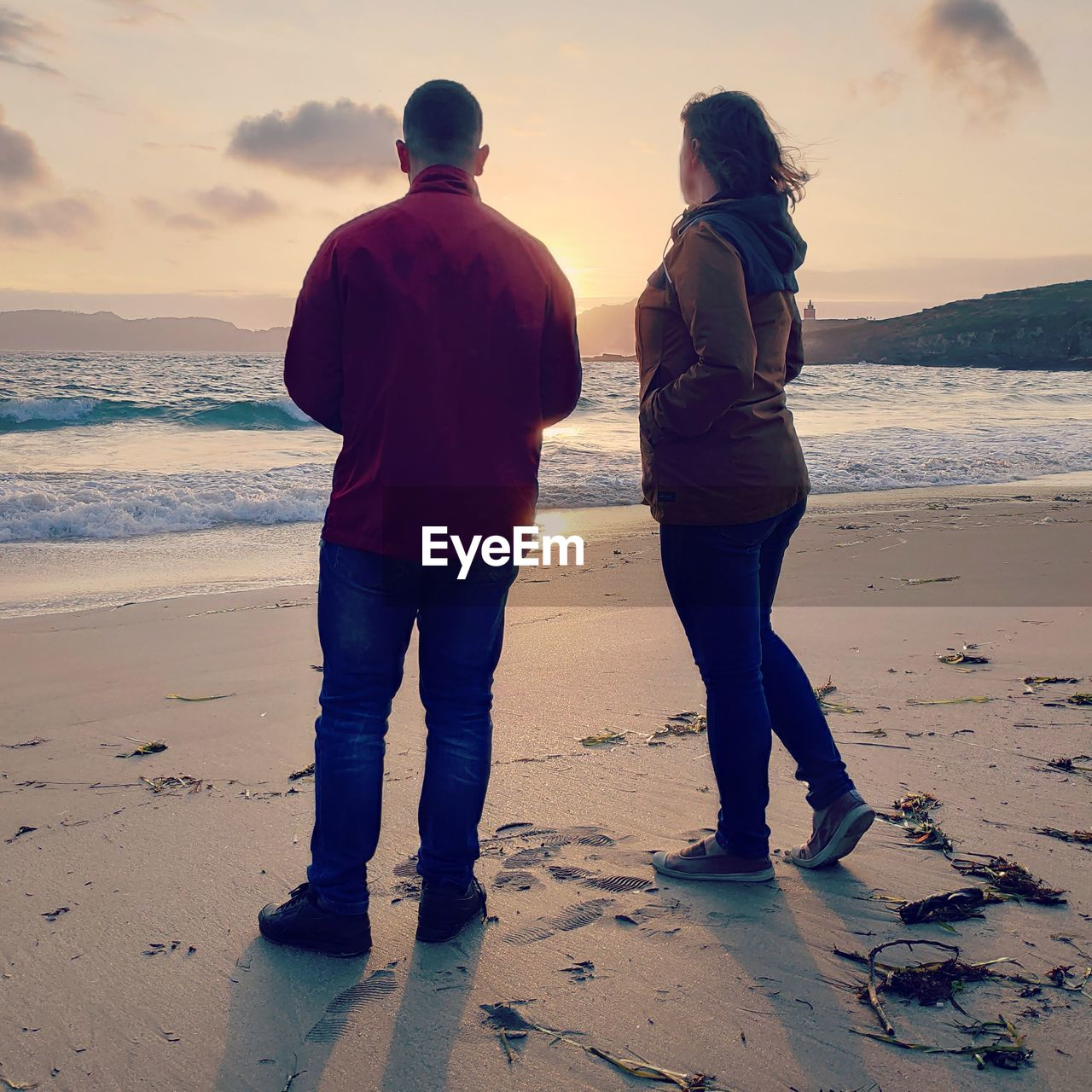 beach, sea, land, sunset, sky, water, two people, real people, rear view, men, full length, togetherness, nature, lifestyles, leisure activity, sand, beauty in nature, scenics - nature, standing, couple - relationship, positive emotion, horizon over water, outdoors
