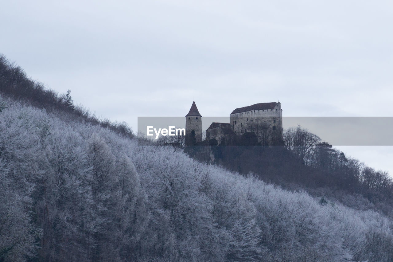 architecture, built structure, building exterior, history, castle, day, fort, travel destinations, no people, nature, outdoors, tree, winter, sky, beauty in nature