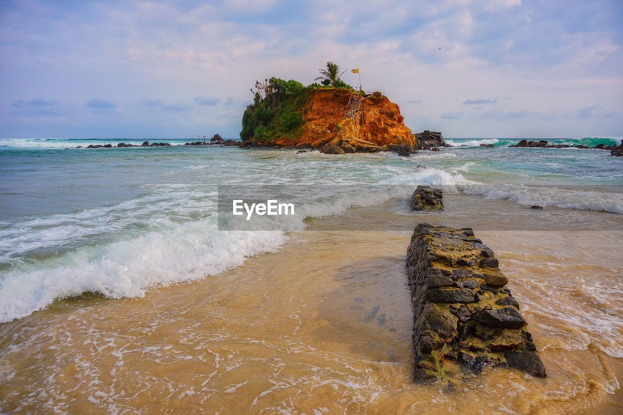 VIEW OF ROCKS ON BEACH
