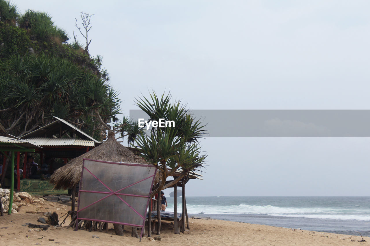 beach, land, sky, water, sea, built structure, architecture, tree, hut, nature, horizon, plant, sand, scenics - nature, beauty in nature, day, cloud - sky, building exterior, horizon over water, no people, outdoors