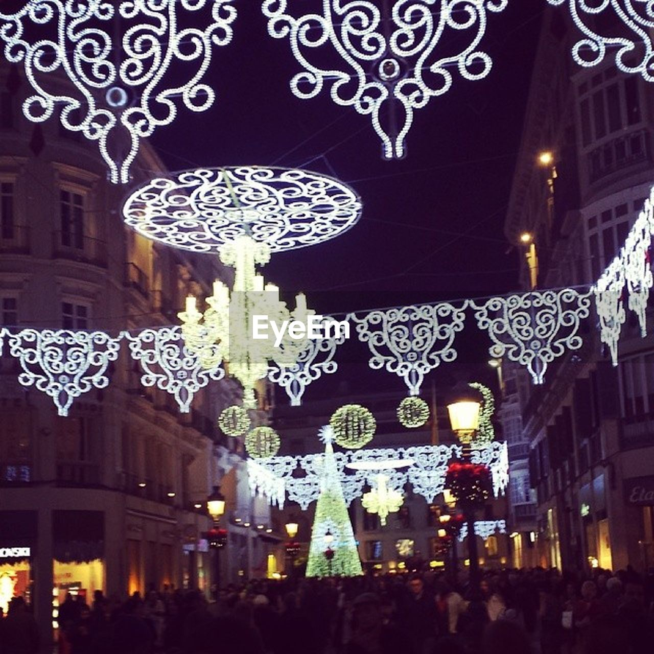 christmas, christmas decoration, illuminated, celebration, night, decoration, christmas lights, lighting equipment, built structure, christmas tree, building exterior, hanging, tradition, architecture, christmas ornament, cultures, city, low angle view, christmas market, outdoors, no people, close-up