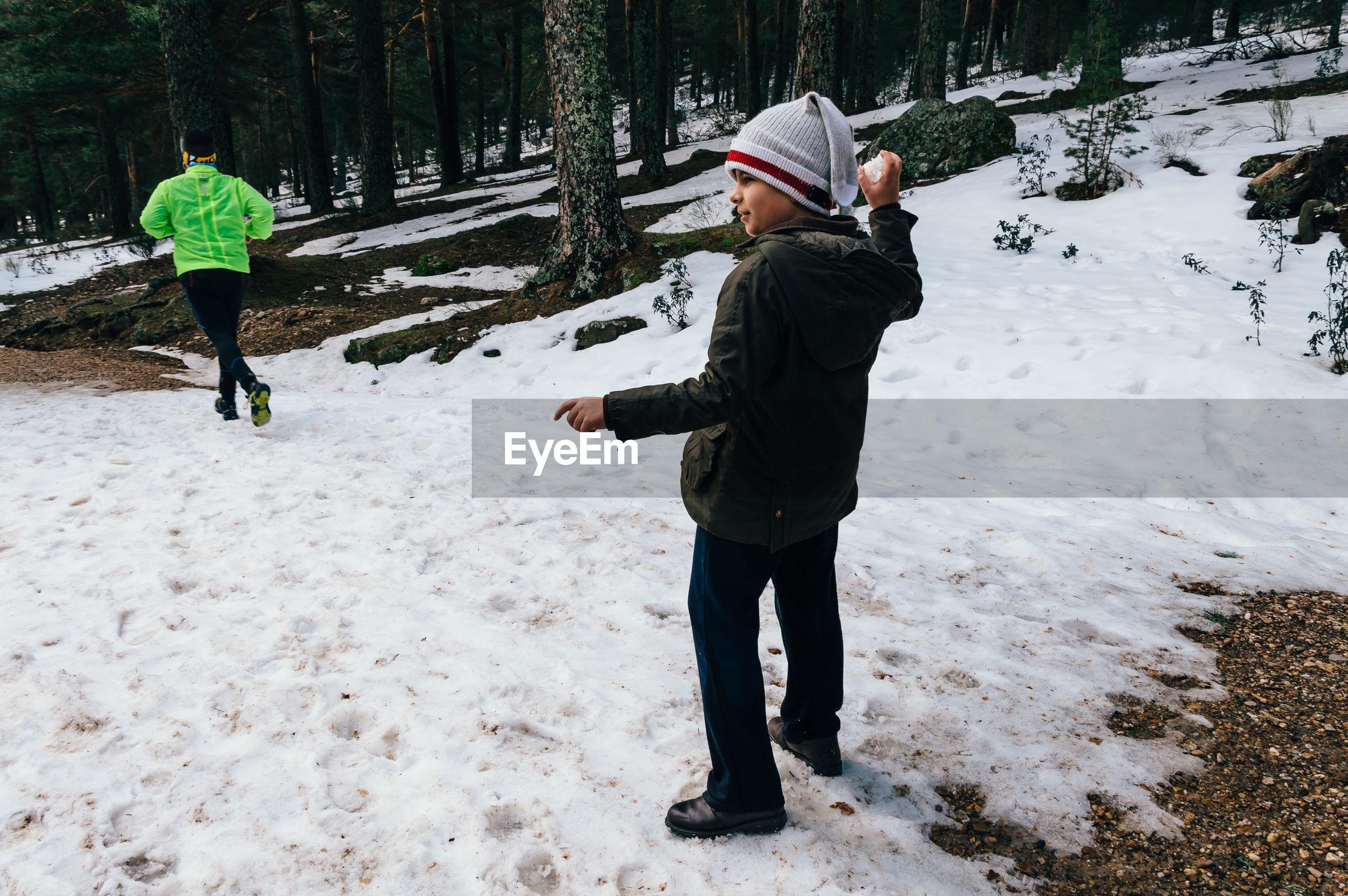 Boy holding a snowball