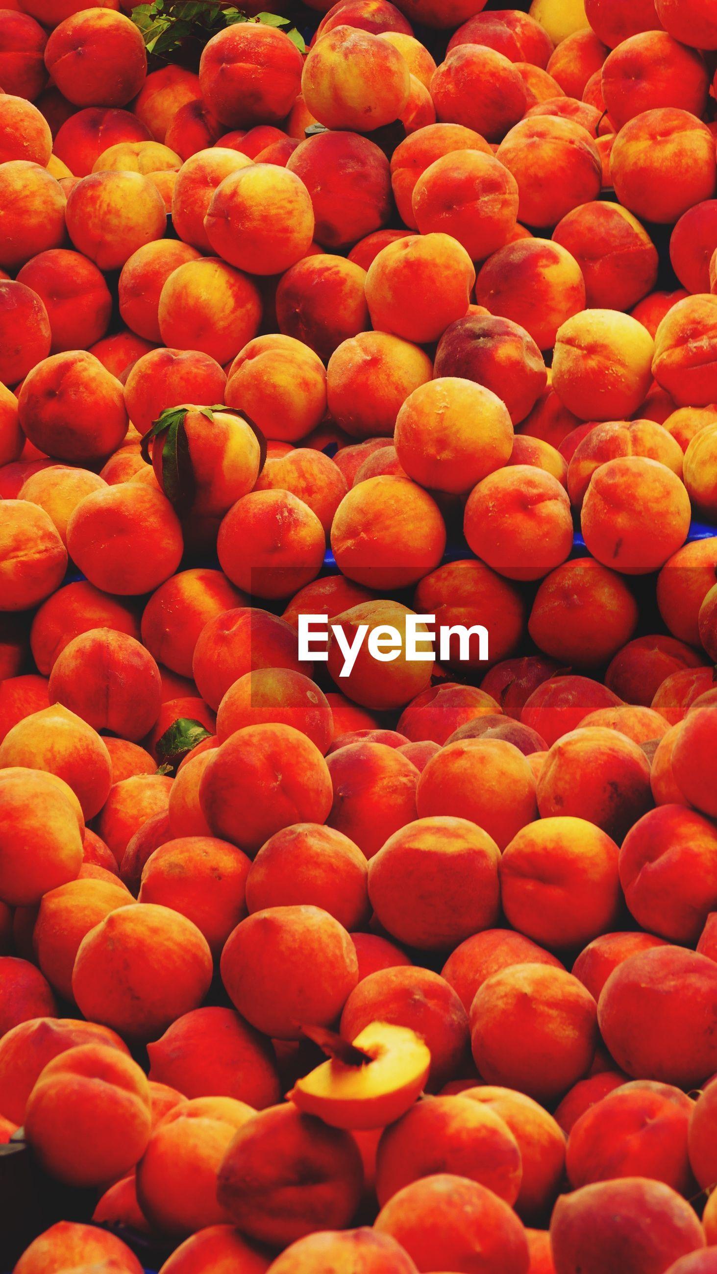 Full frame shot of red peaches for sale in fruit market