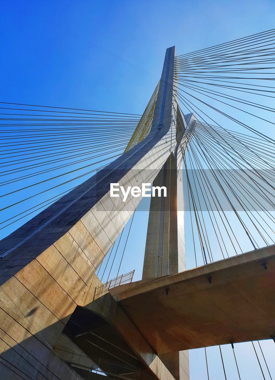built structure, architecture, sky, bridge, bridge - man made structure, connection, low angle view, cable-stayed bridge, engineering, suspension bridge, blue, transportation, clear sky, nature, city, day, building exterior, travel, tourism, outdoors