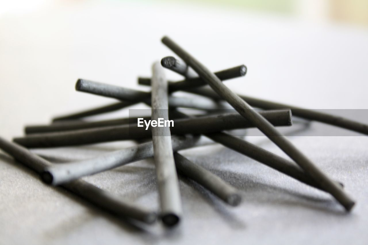 Close-up of pencils on table at home