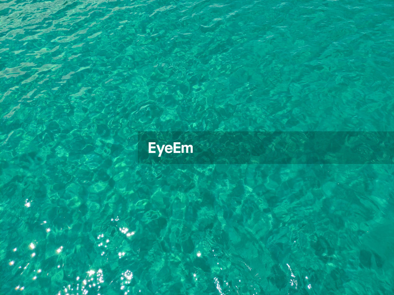 water, backgrounds, full frame, no people, blue, sea, turquoise colored, nature, rippled, day, beauty in nature, pattern, high angle view, outdoors, tranquility, tranquil scene, textured, waterfront, transparent, undersea, abstract, swimming pool, abstract backgrounds