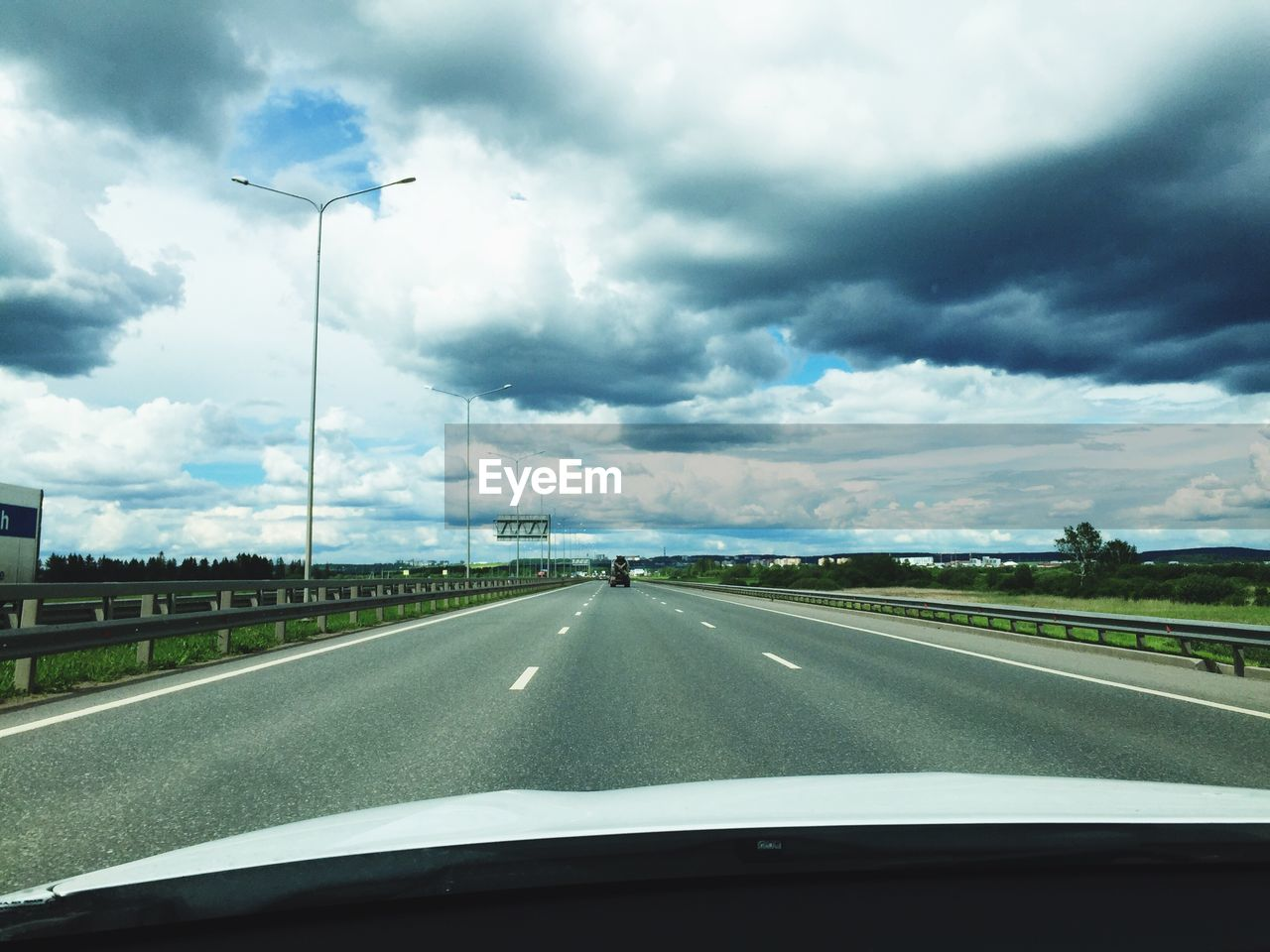 car, car interior, transportation, vehicle interior, road, windshield, cloud - sky, car point of view, glass - material, land vehicle, sky, mode of transport, the way forward, dashboard, travel, highway, driving, road trip, day, journey, nature, windscreen, no people, landscape, storm cloud, scenics, outdoors