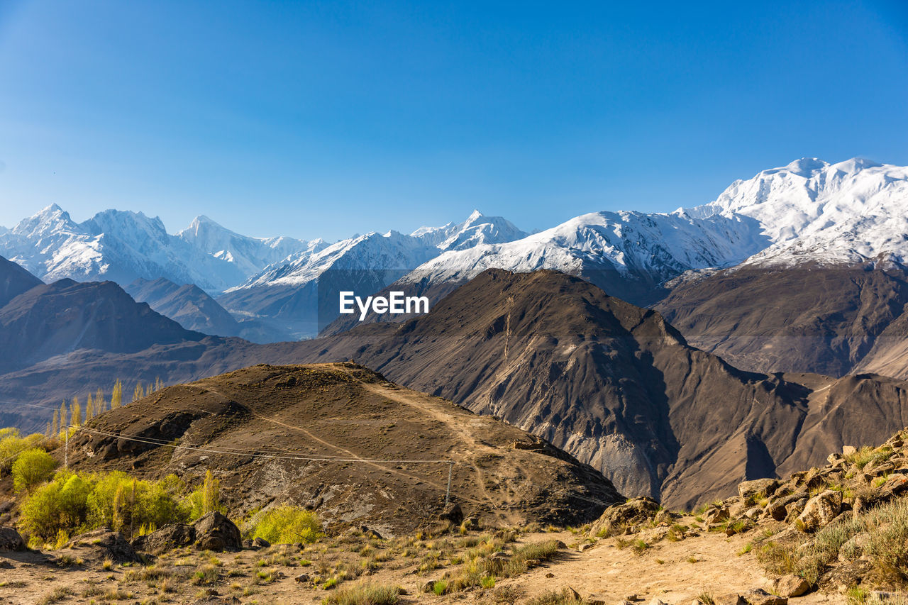 mountain, scenics - nature, beauty in nature, sky, mountain range, environment, tranquil scene, winter, cold temperature, landscape, snow, tranquility, non-urban scene, nature, snowcapped mountain, no people, day, clear sky, sunlight, outdoors, mountain peak, formation, range