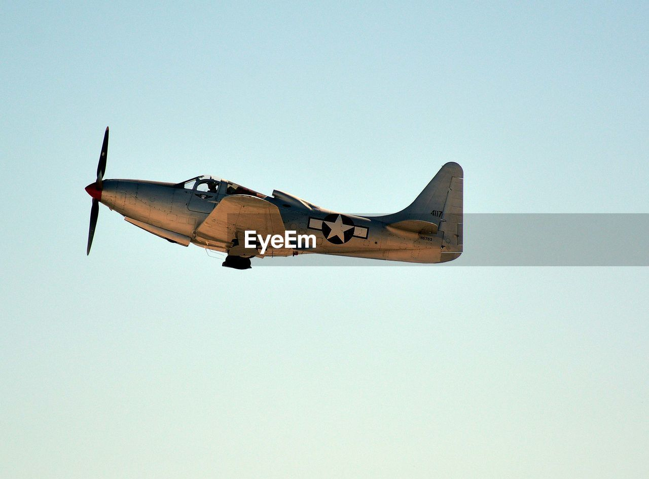 clear sky, copy space, airplane, low angle view, air vehicle, transportation, flying, no people, outdoors, day, military, sky