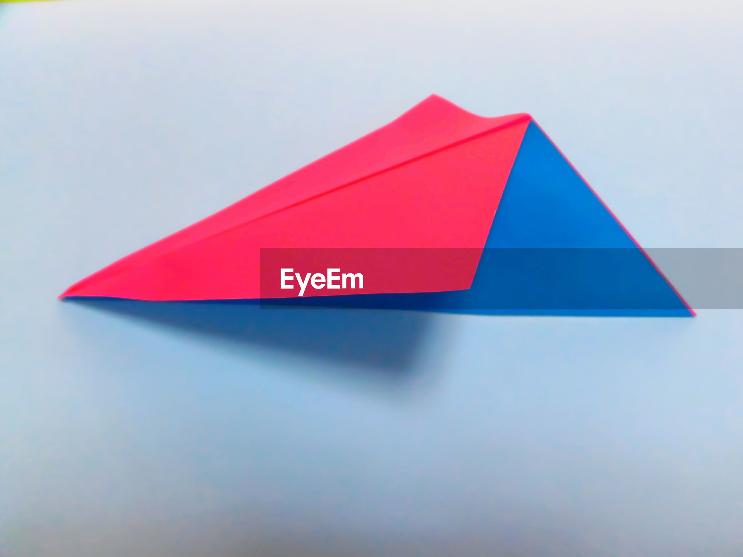 High angle view of paper airplane on gray background