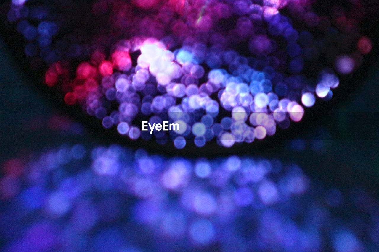 close-up, no people, defocused, illuminated, night, purple, lighting equipment, glowing, selective focus, nature, outdoors, light - natural phenomenon, pattern, blue, electricity, light, beauty in nature, backgrounds, shape, decoration, nightlife