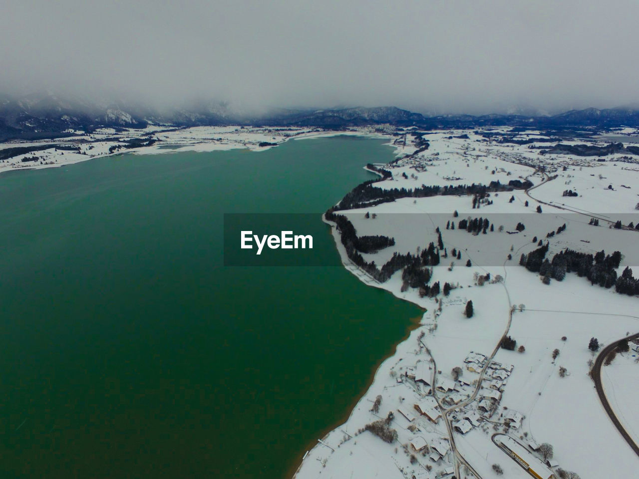 beauty in nature, nature, aerial view, scenics, tranquil scene, landscape, tranquility, outdoors, water, lake, winter, cold temperature, mountain, day, no people, snow, patchwork landscape, sky