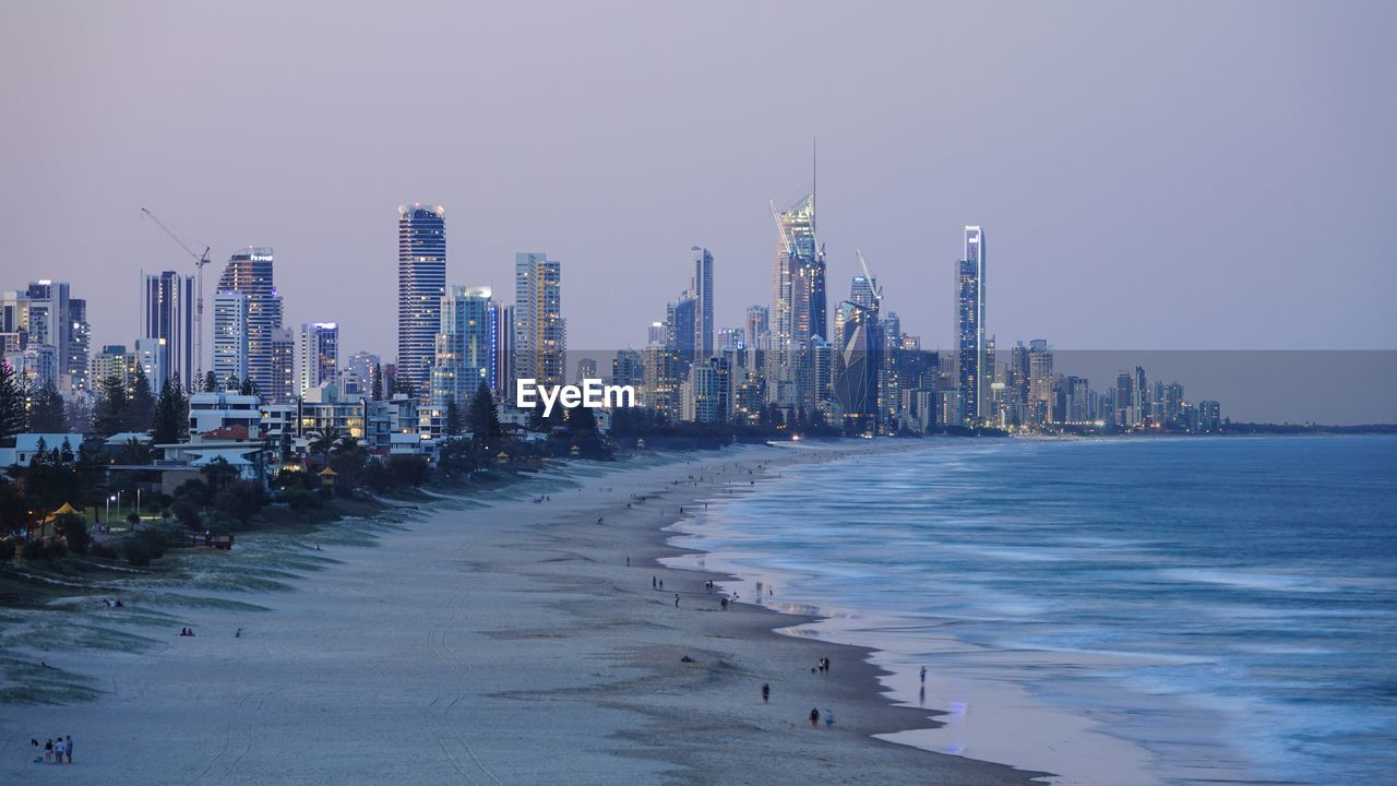 PANORAMIC SHOT OF SEA AND BUILDINGS AGAINST SKY