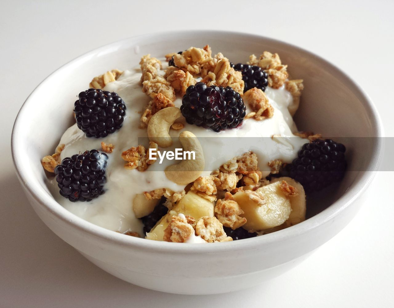 food and drink, food, healthy eating, fruit, freshness, bowl, wellbeing, berry fruit, ready-to-eat, meal, still life, breakfast, breakfast cereal, dairy product, blueberry, white background, indulgence, studio shot, yogurt, close-up, no people, temptation, oatmeal