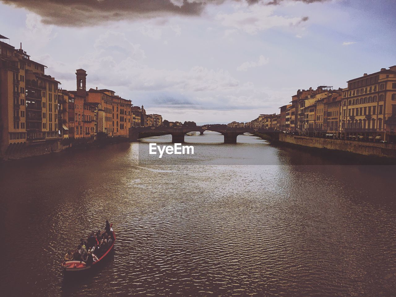 High Angle View Of Boat Moving On Arno River At Ponte Vecchio