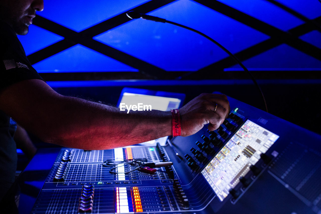 technology, one person, indoors, human hand, music, hand, real people, occupation, skill, dj, sound mixer, human body part, control, audio equipment, sound recording equipment, men, adjusting, mixing, working, finger, nightlife, club dj