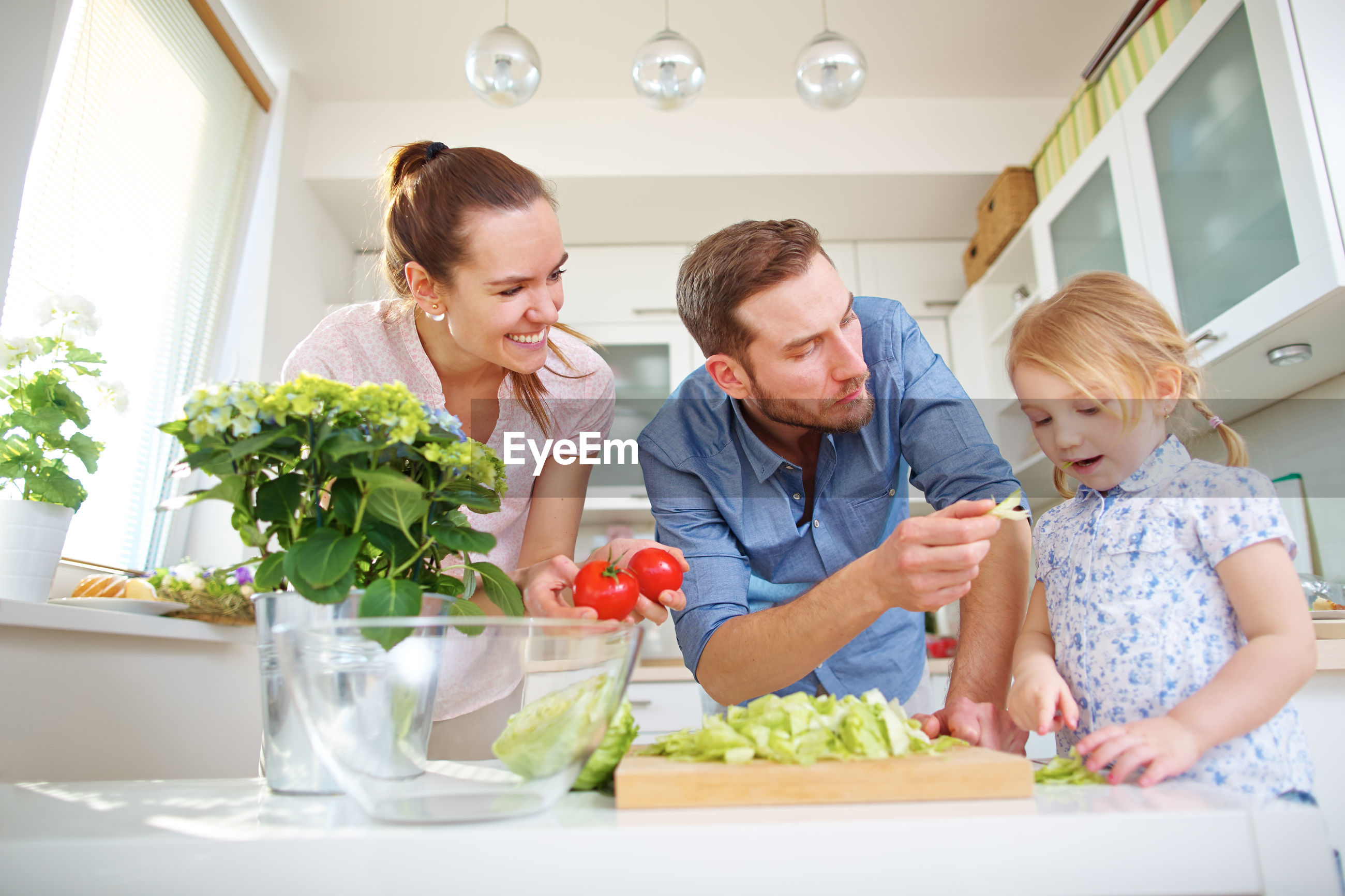 High angle view of people having food at home