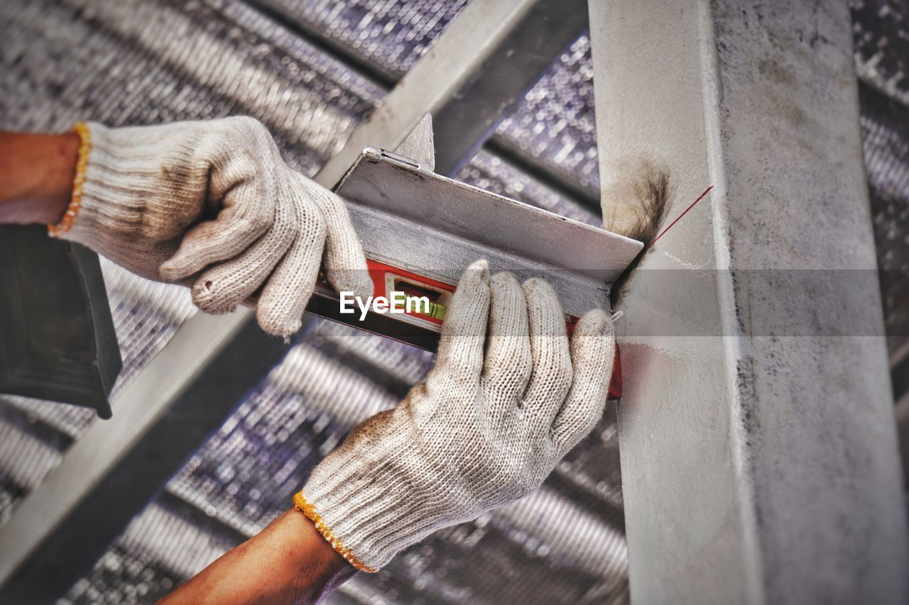 Close-Up Of Man Hands Checking Level Of Metal With Spirit