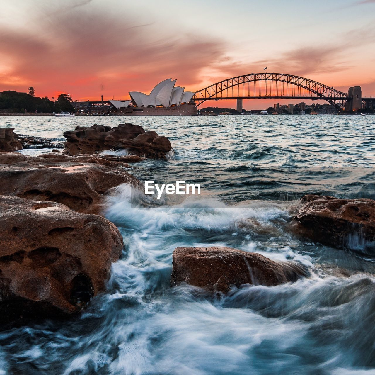 water, sunset, built structure, sea, sky, bridge, rock, bridge - man made structure, architecture, connection, rock - object, motion, cloud - sky, nature, solid, transportation, scenics - nature, no people, beauty in nature, outdoors, bay