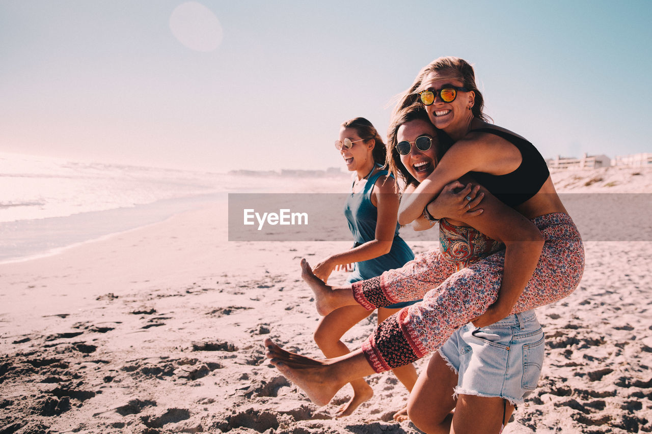 land, beach, leisure activity, togetherness, sky, emotion, women, real people, sea, lifestyles, holiday, child, nature, girls, water, vacations, trip, bonding, glasses, adult, positive emotion, fashion, daughter