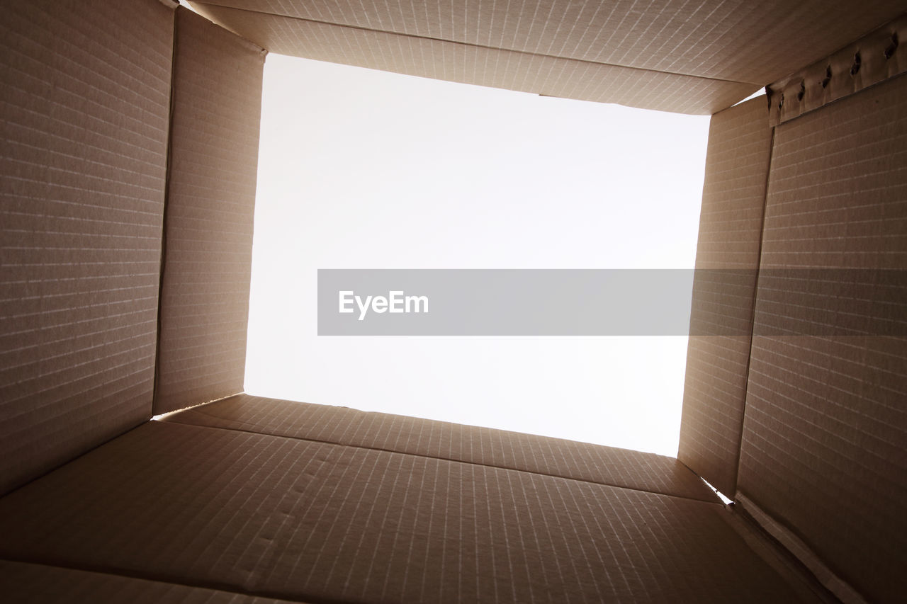 Open cardboard box against white background