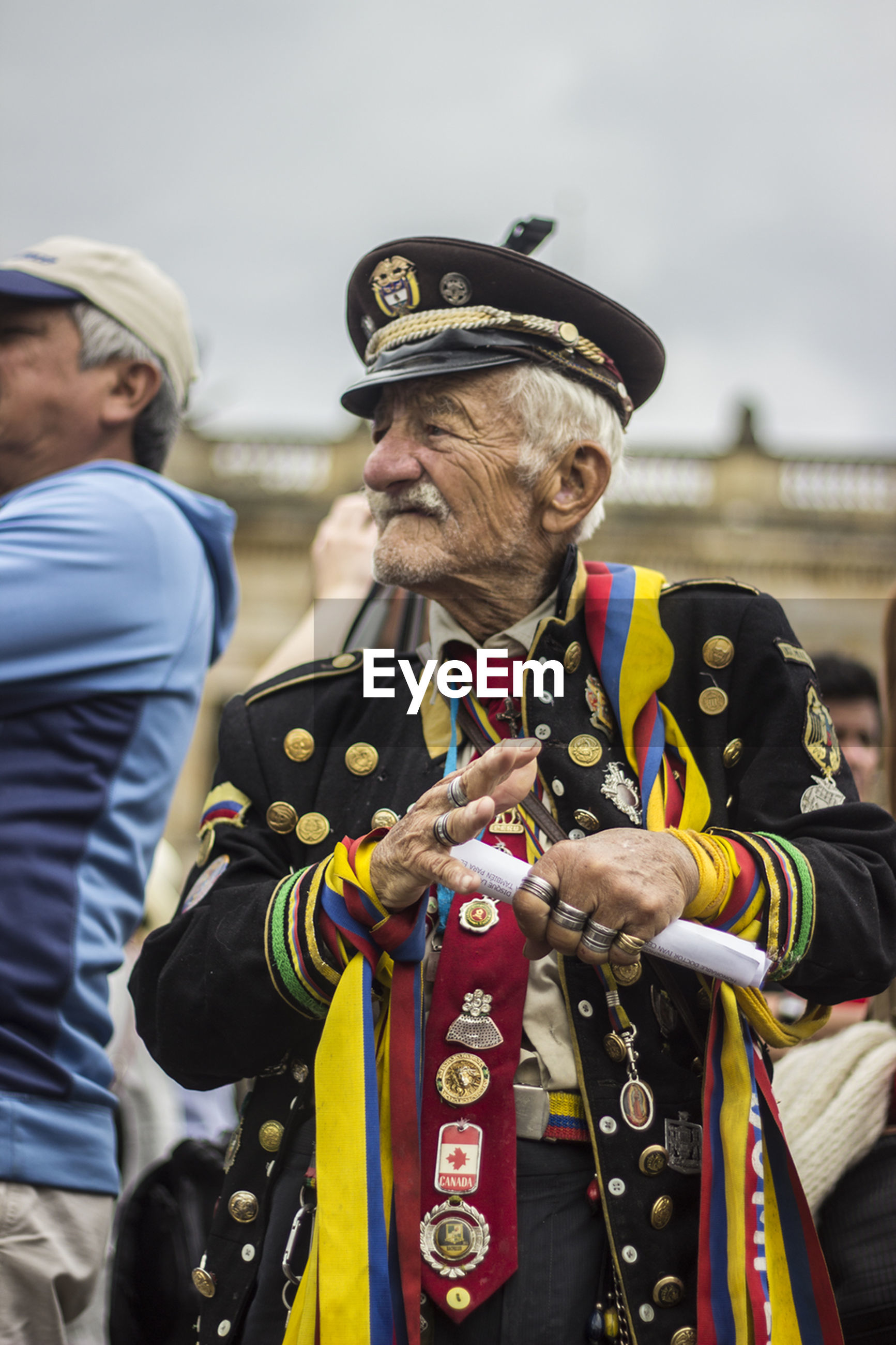 Mature man in uniform looking away