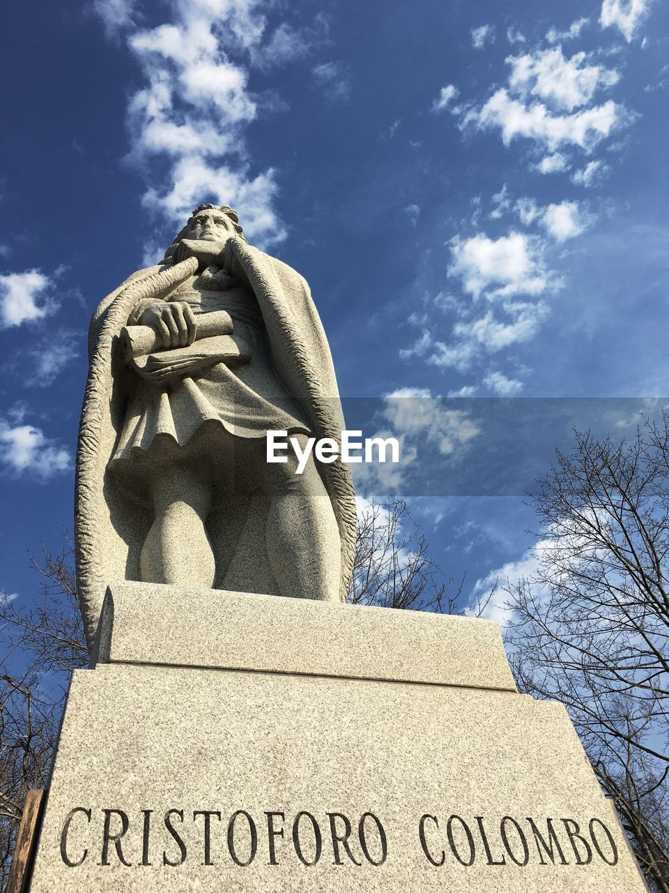 art and craft, statue, sculpture, sky, low angle view, representation, human representation, male likeness, no people, communication, architecture, cloud - sky, text, day, western script, nature, creativity, memorial, history
