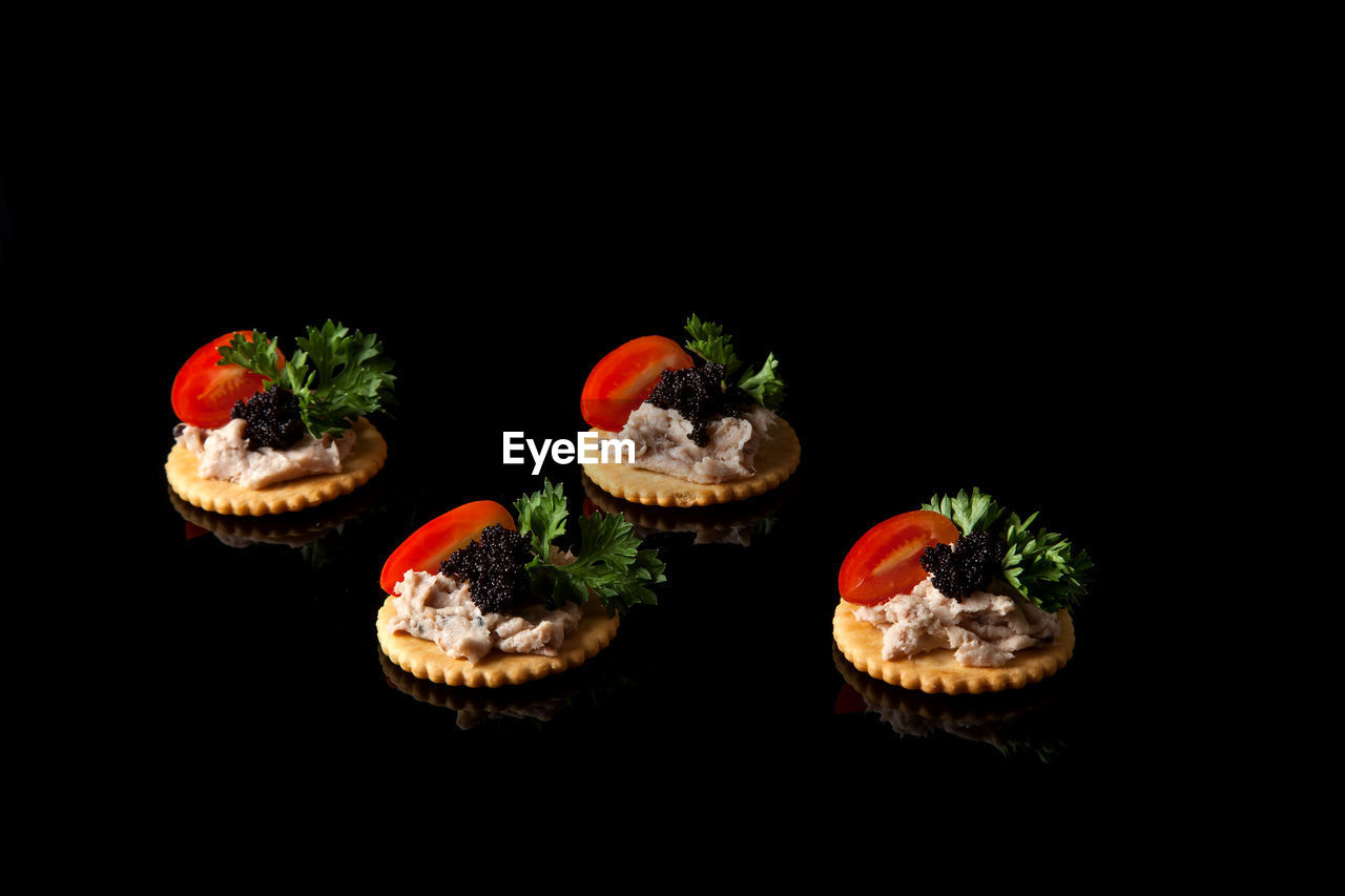 food and drink, food, studio shot, black background, freshness, indoors, fruit, copy space, no people, healthy eating, close-up, still life, vegetable, ready-to-eat, wellbeing, tomato, red, indulgence, cut out, sweet food, temptation