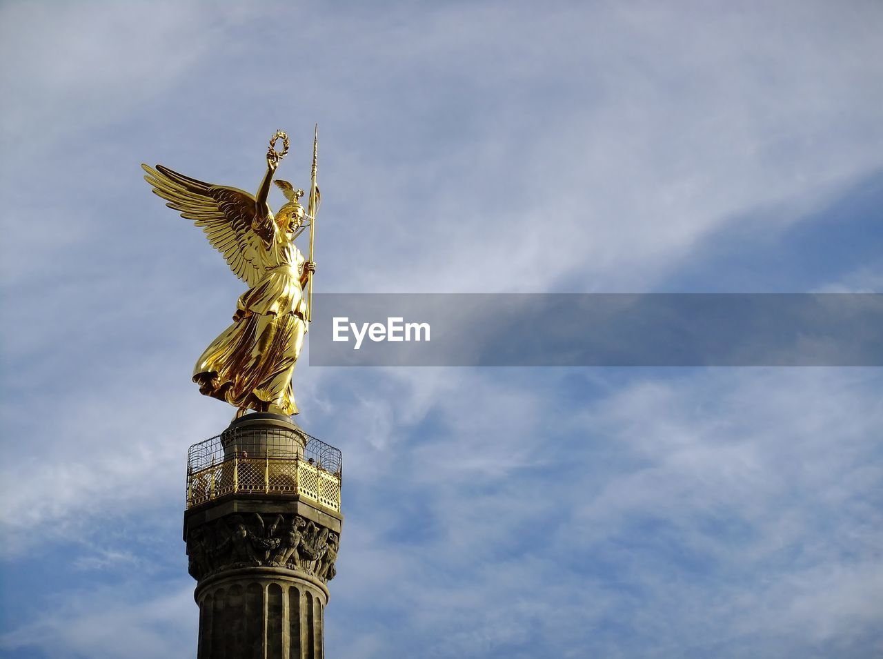 High section of statue against the sky