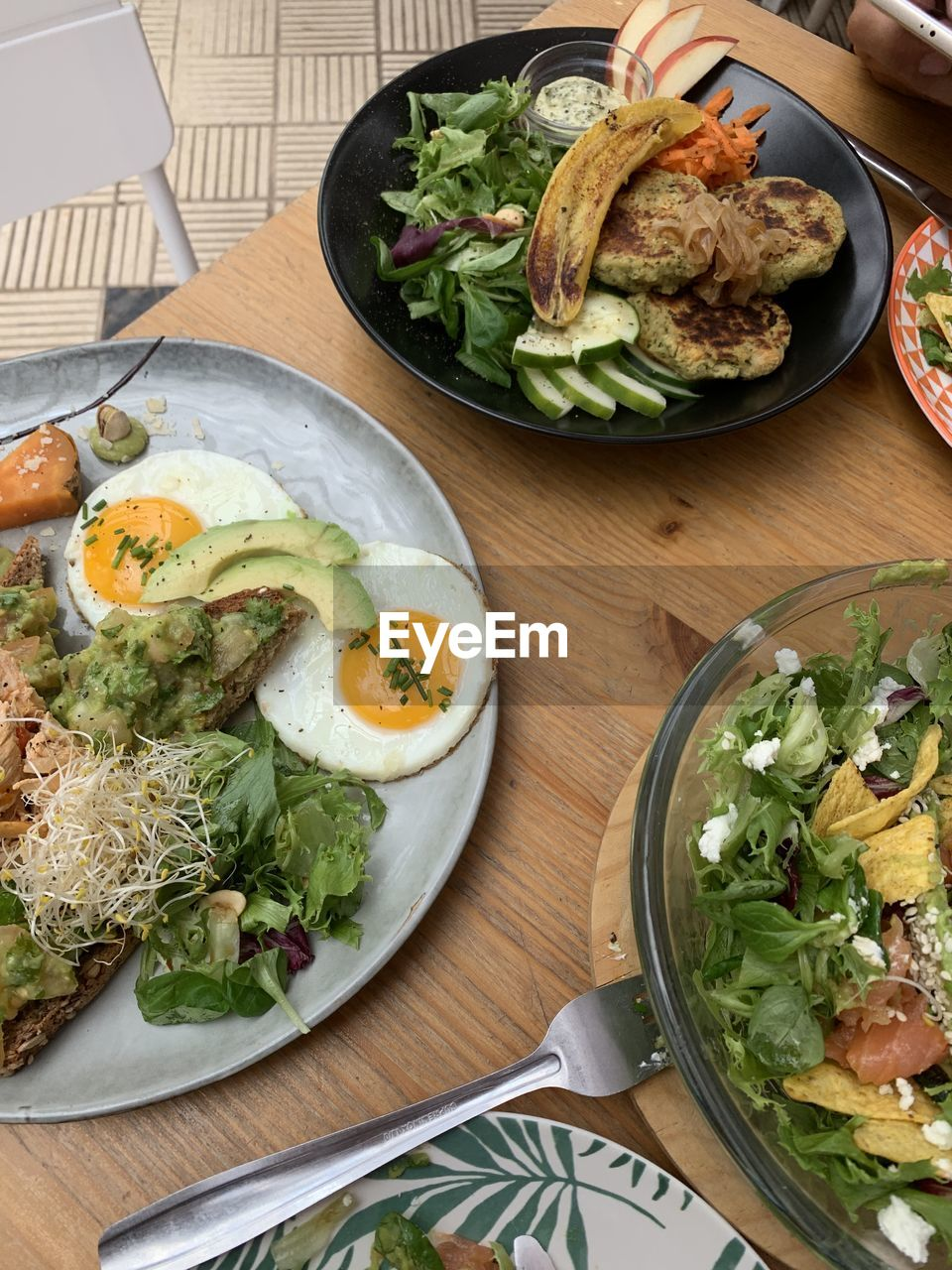 food and drink, food, healthy eating, vegetable, freshness, ready-to-eat, table, wellbeing, meal, salad, egg, high angle view, no people, serving size, indoors, lettuce, still life, wood - material, fork, fried, breakfast, fried egg, egg yolk