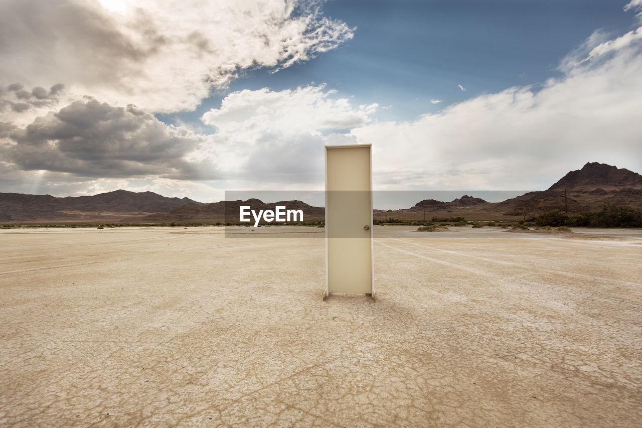 Door on barren landscape