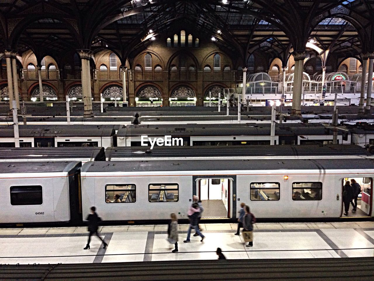 public transportation, railroad station, real people, transportation, large group of people, railroad station platform, rail transportation, train - vehicle, architecture, men, women, built structure, day, people, adults only, adult, indoors, city, subway train, building exterior, clock