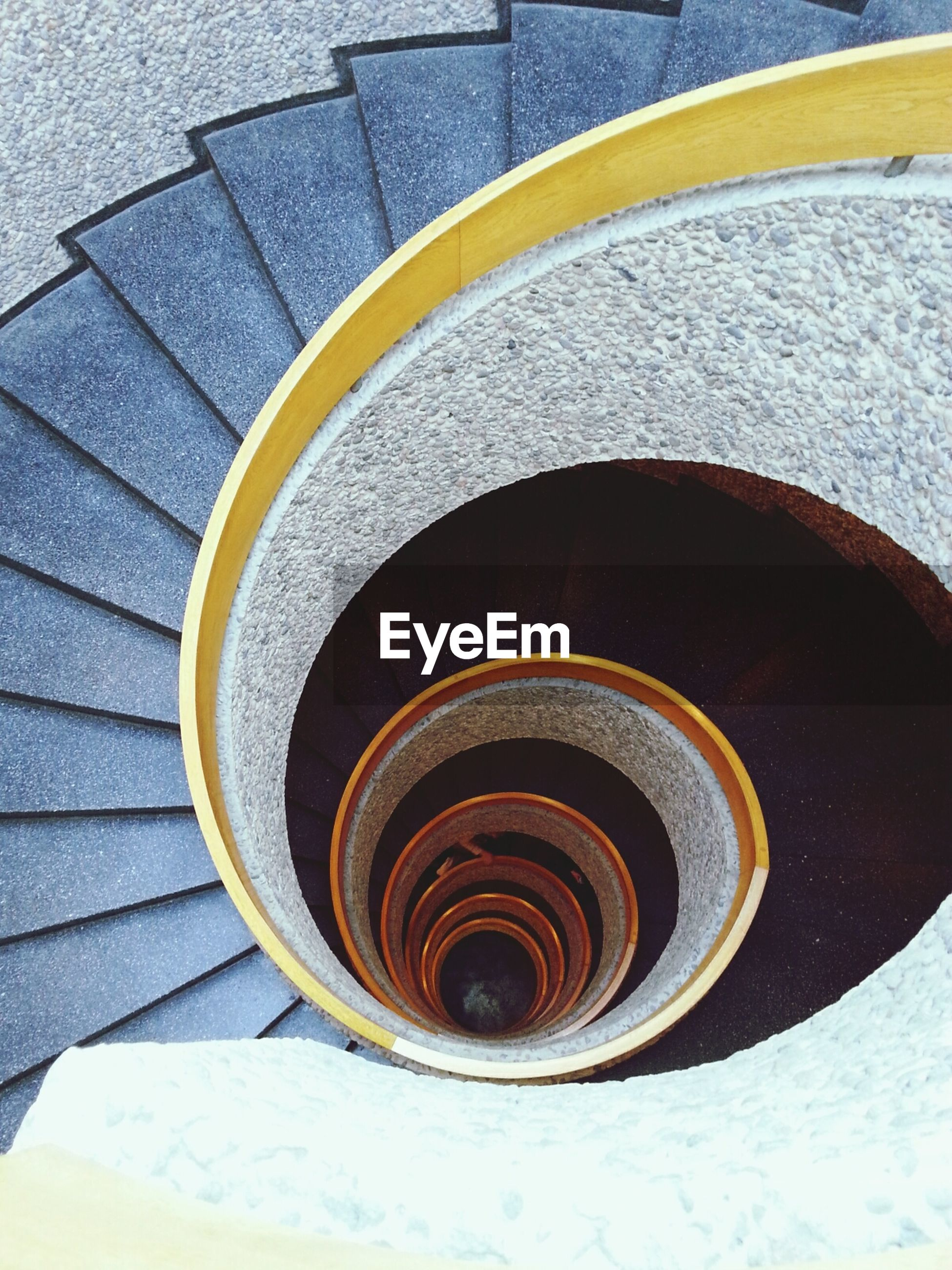 steps, steps and staircases, staircase, circle, spiral, high angle view, spiral staircase, pattern, railing, built structure, architecture, geometric shape, building exterior, design, directly above, no people, curve, indoors, close-up