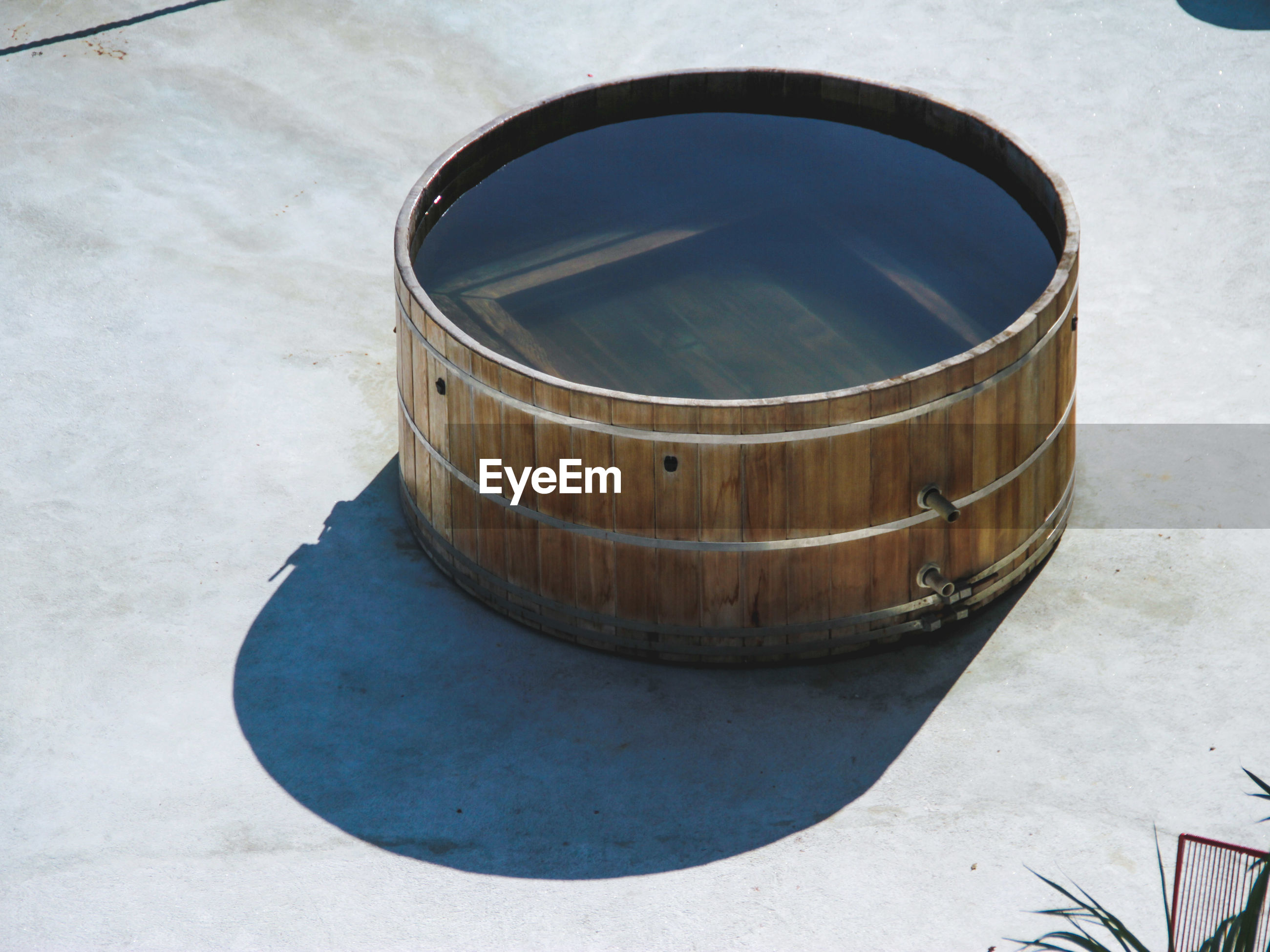 High angle view of water in wooden container during sunny day