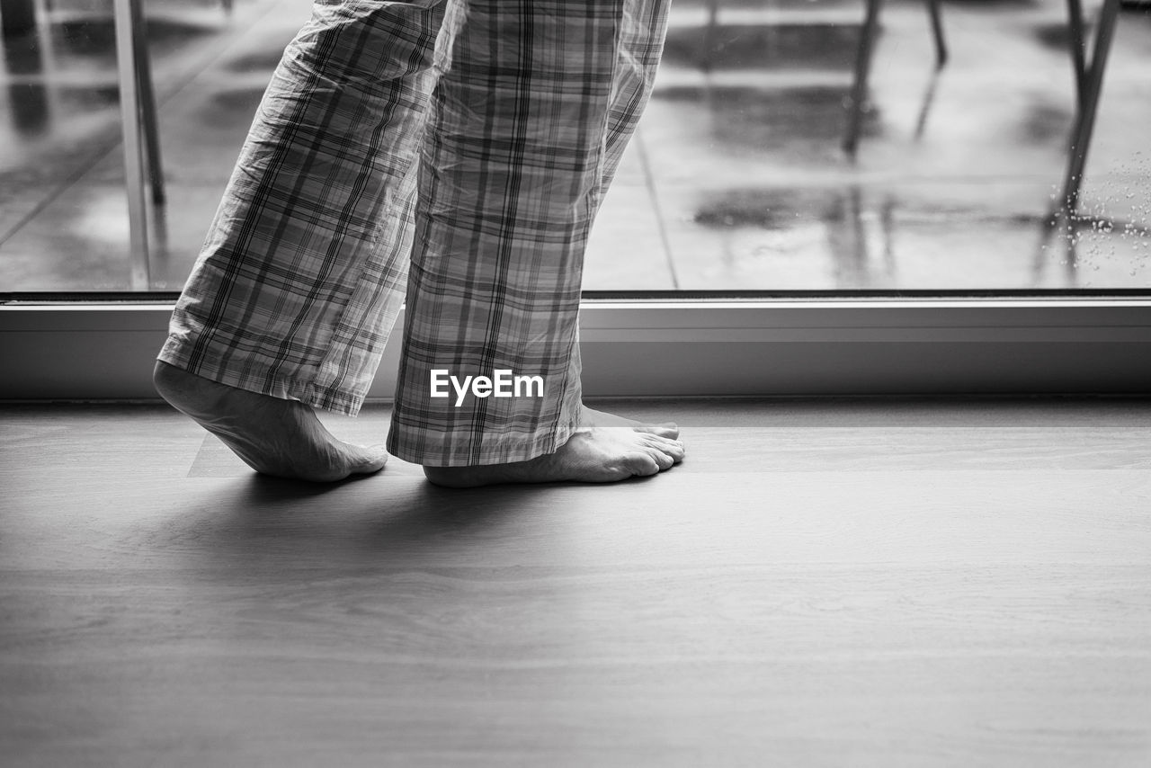 Low Section Of A Barefoot Senior Woman Indoors