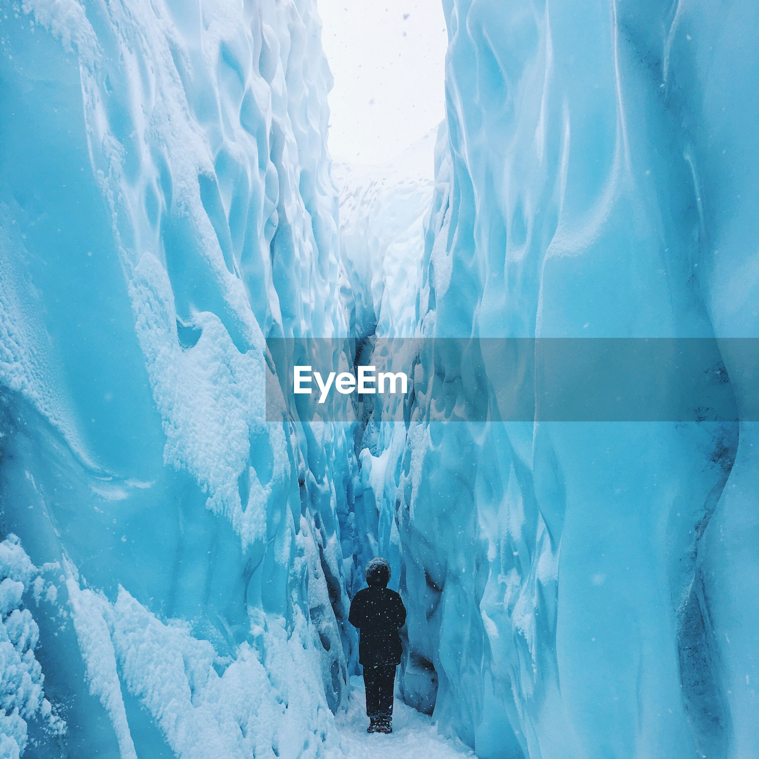 Rear view full length of person amidst glaciers