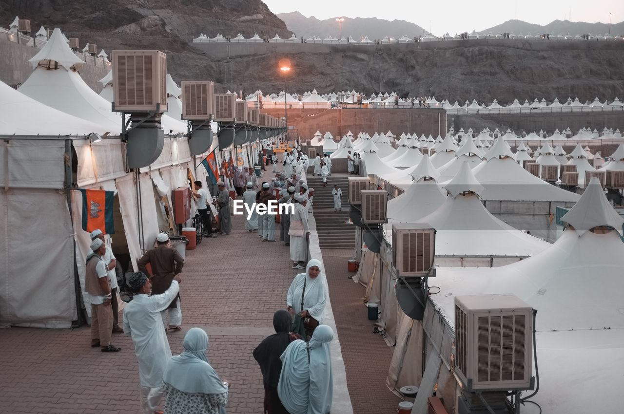 High Angle View Of People In Religious Events By Tents